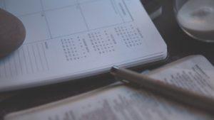 Planner on desk with timer